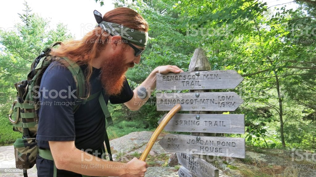 Bearded Survivalist Backpacker Hiker, Reading Sign, Acadia National Park, Maine stock photo