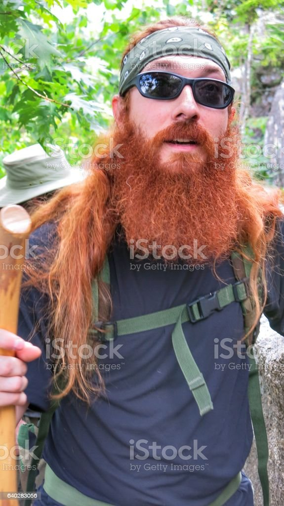 Bearded Survivalist Backpacker Hiker, Walking Stick, Acadia National Park, Maine stock photo