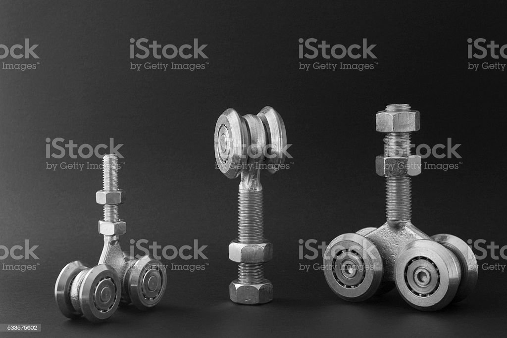 Bearings for sliding gates isolated on a black background stock photo