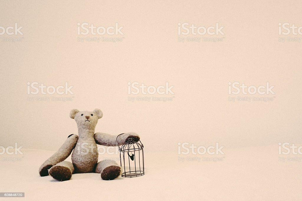 Bear's stuffed toy has a cage stock photo