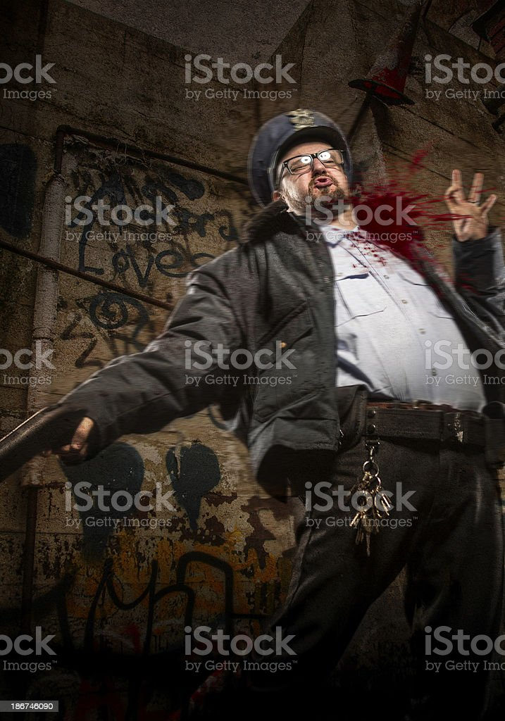 Beat Cop Policeman being shot in neck royalty-free stock photo