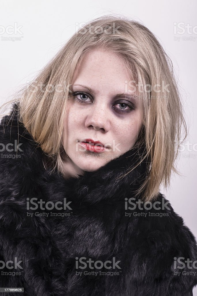 beaten and abused woman with a black eye royalty-free stock photo
