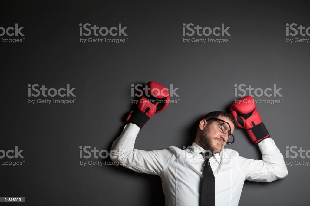 Beaten Businessman Lying Down stock photo