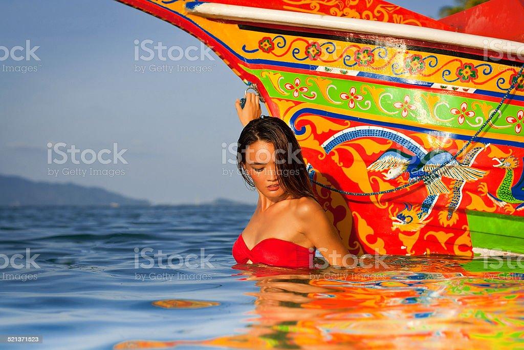 Beatiful asian girl in a sea stock photo