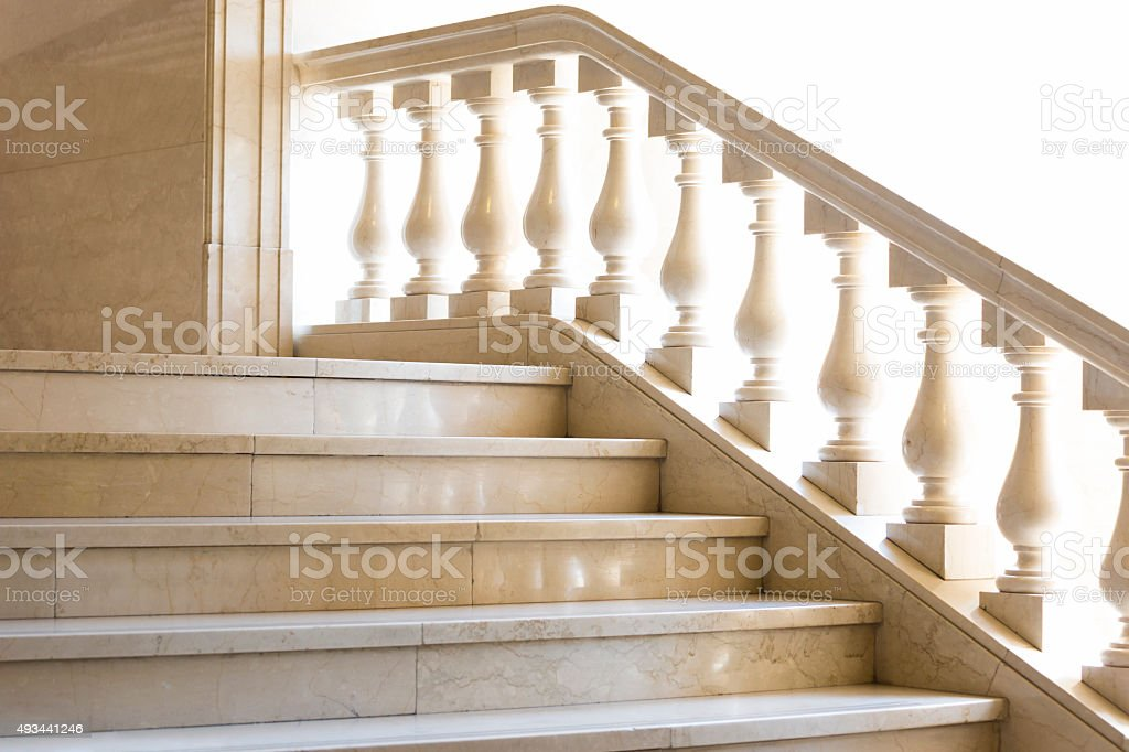 Beatiful marble staircase with balustrade agaist white background, copy space stock photo