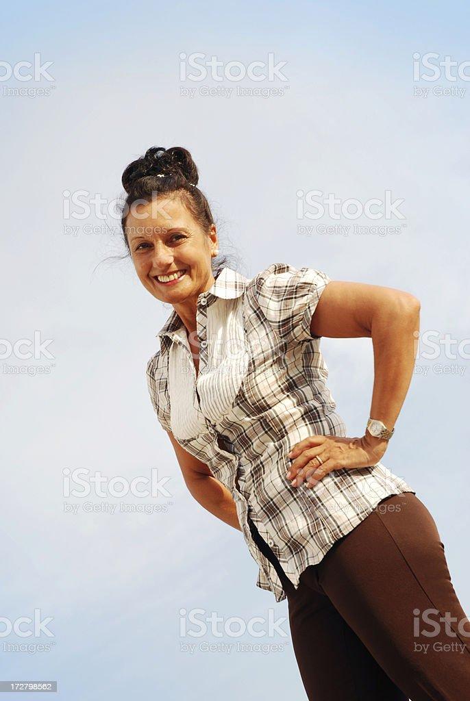 Beatiful matire lady on blue sky. royalty-free stock photo