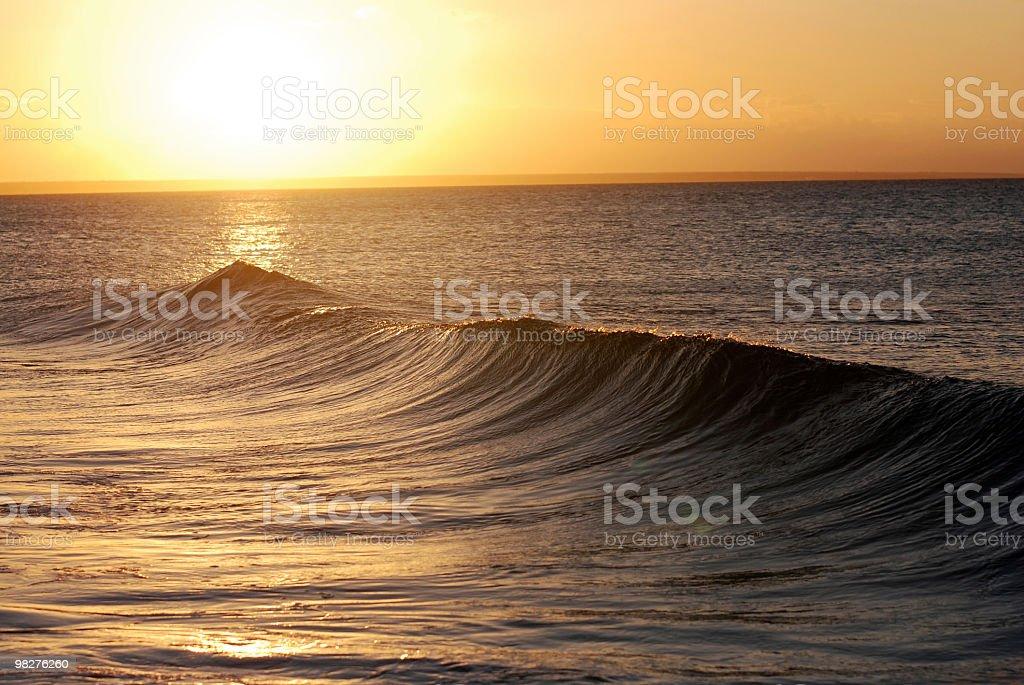 beatiful sunset with splashing waves in front stock photo