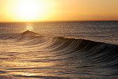beatiful sunset with splashing waves in front
