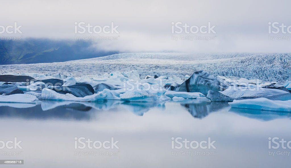 Beatiful vibrant picture of icelandic glacier and glacier lagoon stock photo