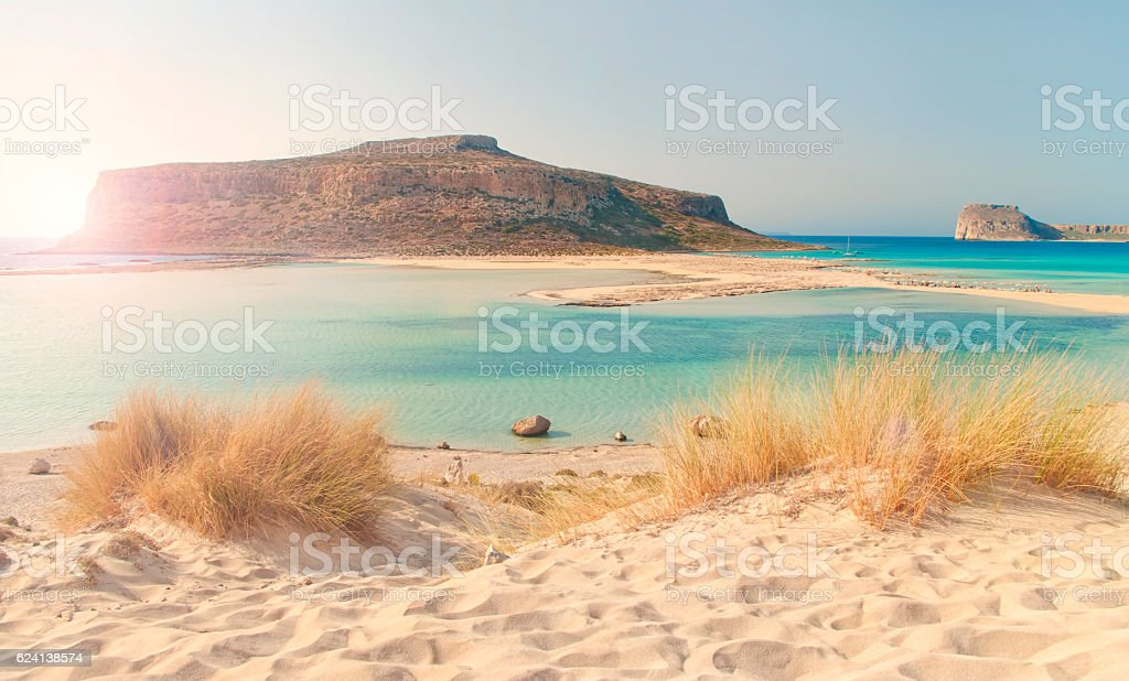 beatiful view of sea bay with islet at sunset stock photo