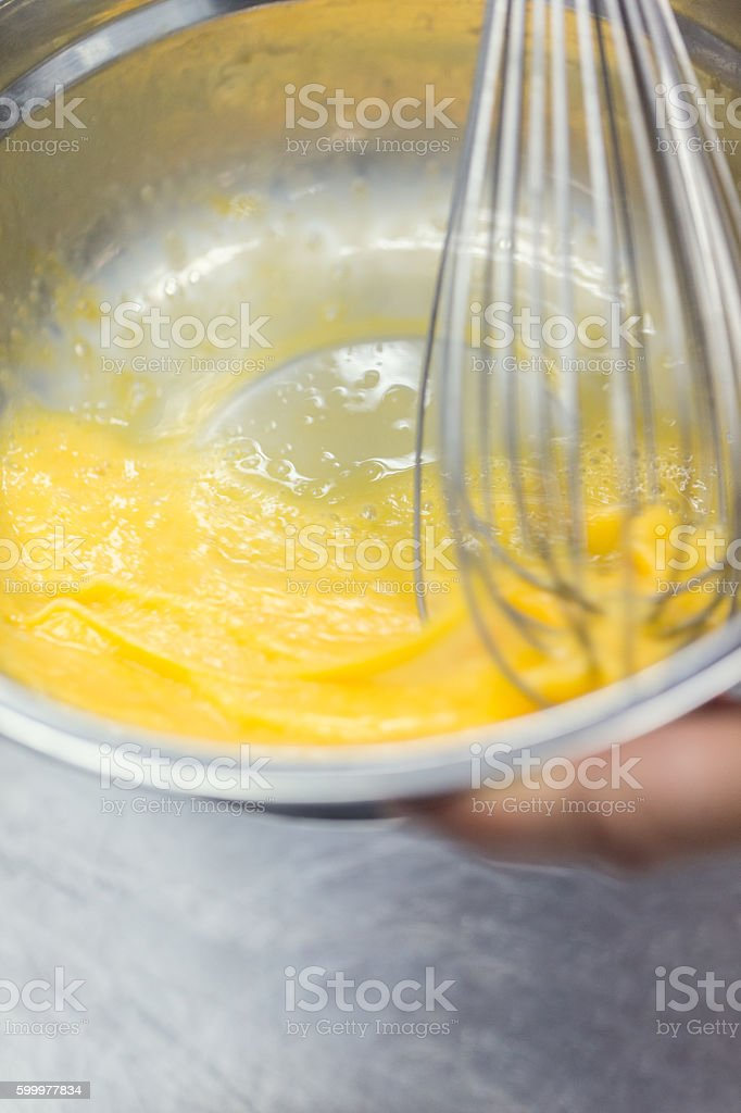 Beating egg yolks stock photo