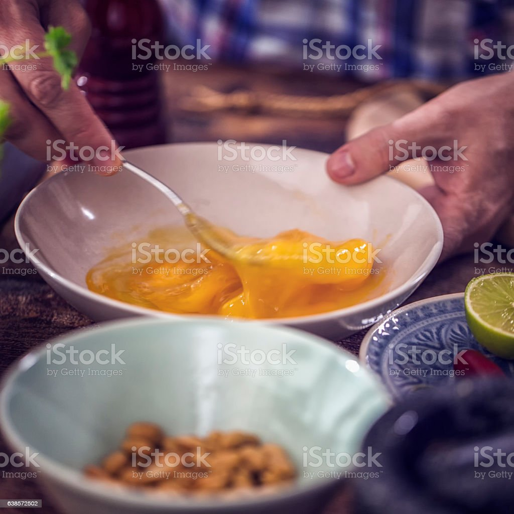 Beating Fresh Eggs for Preparing Batter stock photo