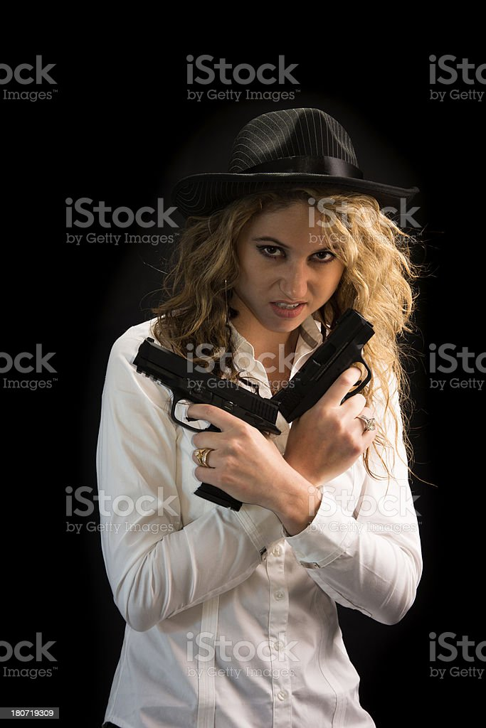 Beatuiful Woman Wearing Gangster Hat Holding Two Pistols stock photo