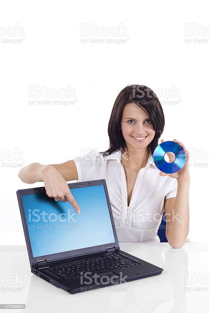 Beauiful Woman - Presentation with laptop and cd royalty-free stock photo