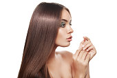 Beauiful Woman With Healthy Brown Hair. Long Shiny Straight Hair.