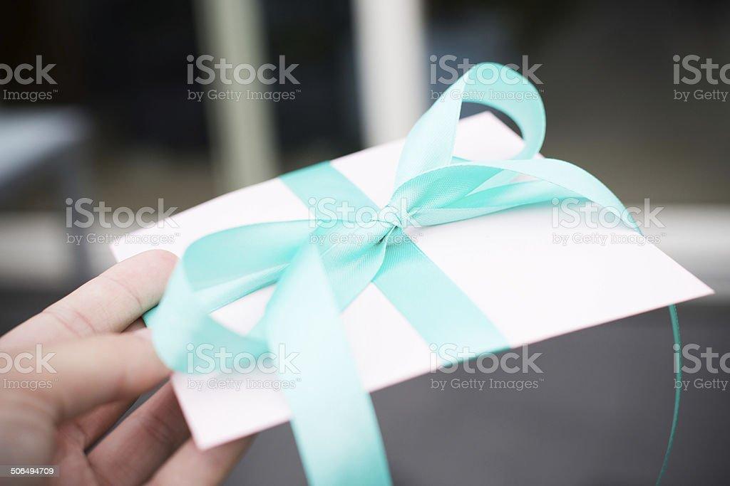 Beautfully wrapped gift - enevelope stock photo