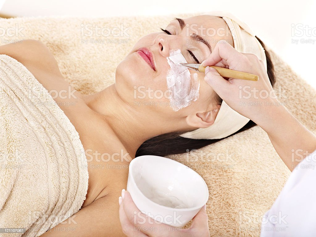 Beautician applying  facial mask by  woman. royalty-free stock photo