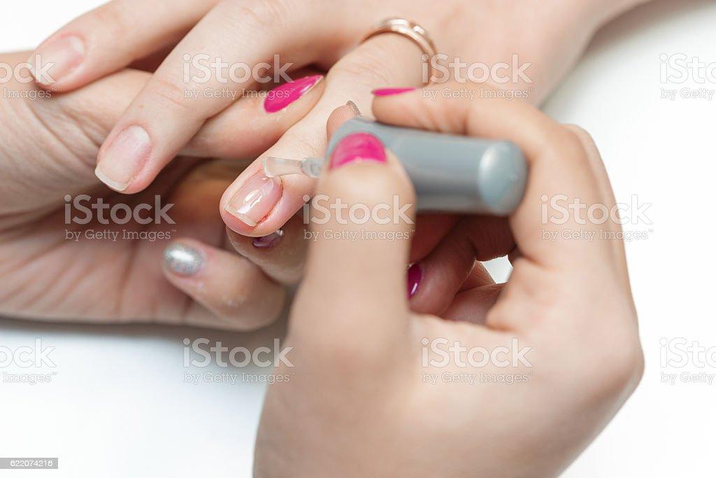 beautician applying Polish nails stock photo