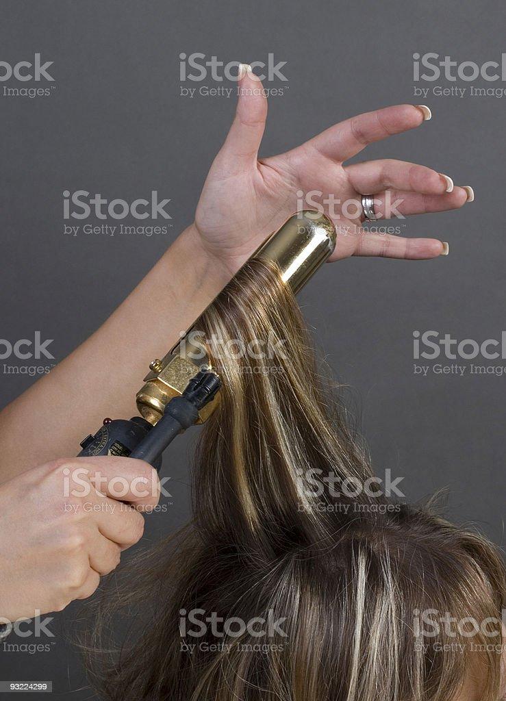 Beautician Curling Hair stock photo