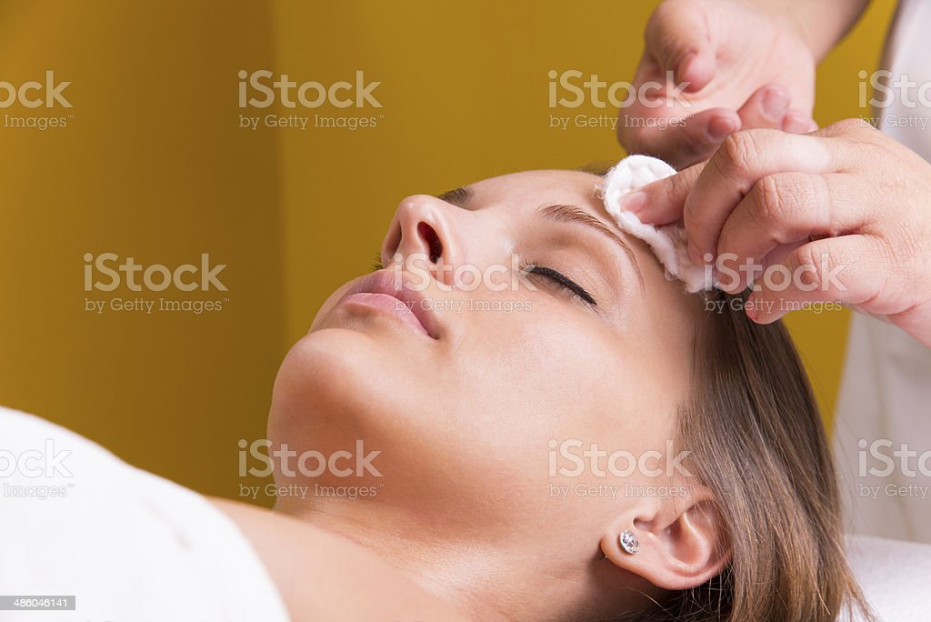 Beautician face cleaning. stock photo