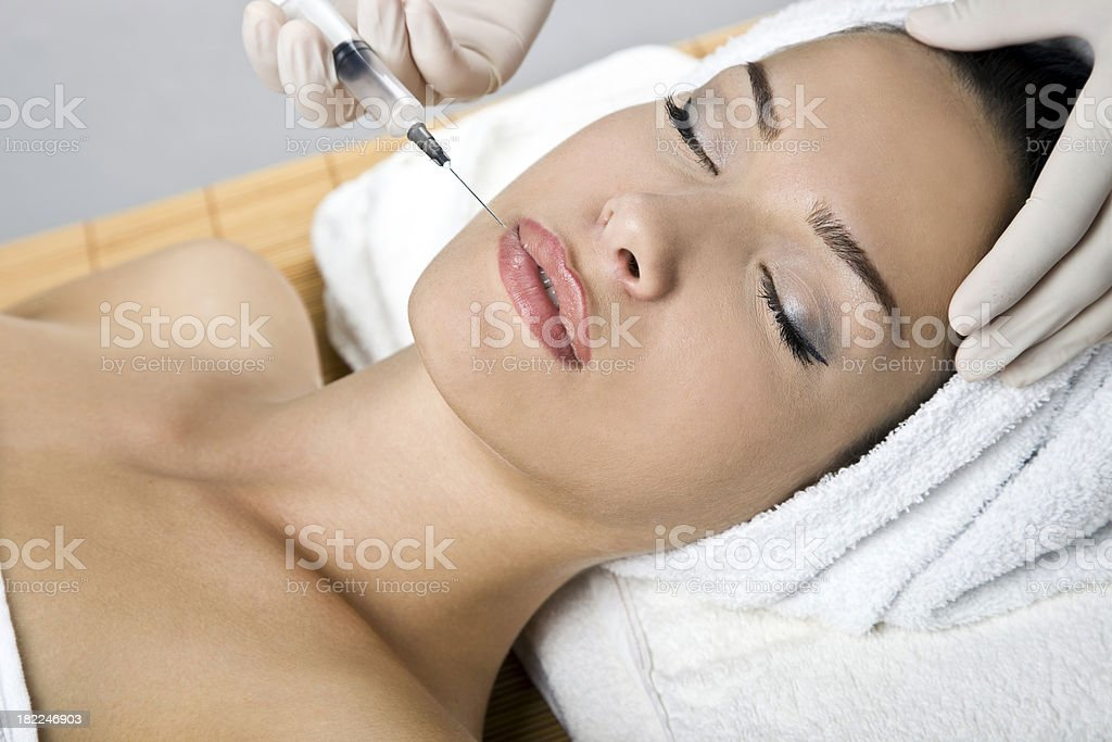 Beautician giving an injection royalty-free stock photo