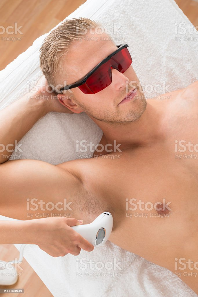 Beautician Giving Laser Epilation Treatment stock photo