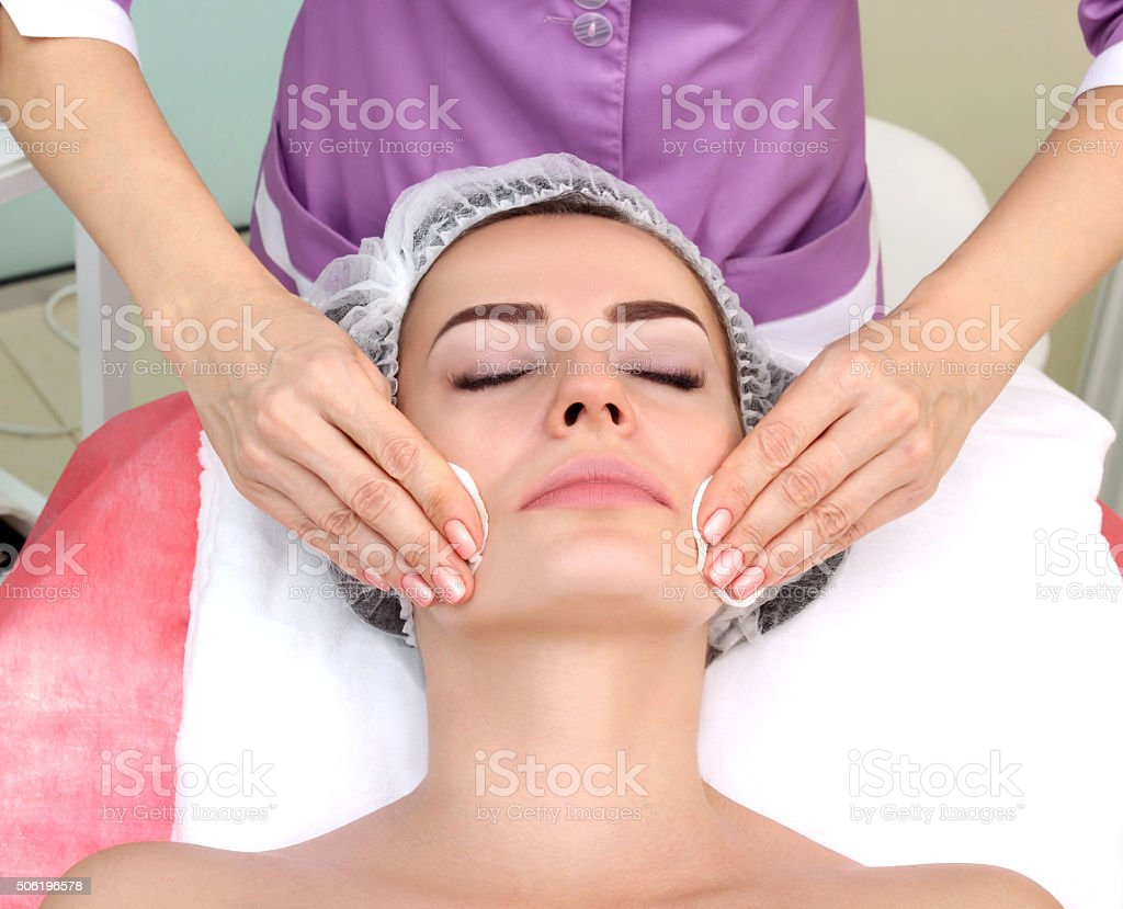 Beautician makes cleansing. royalty-free stock photo