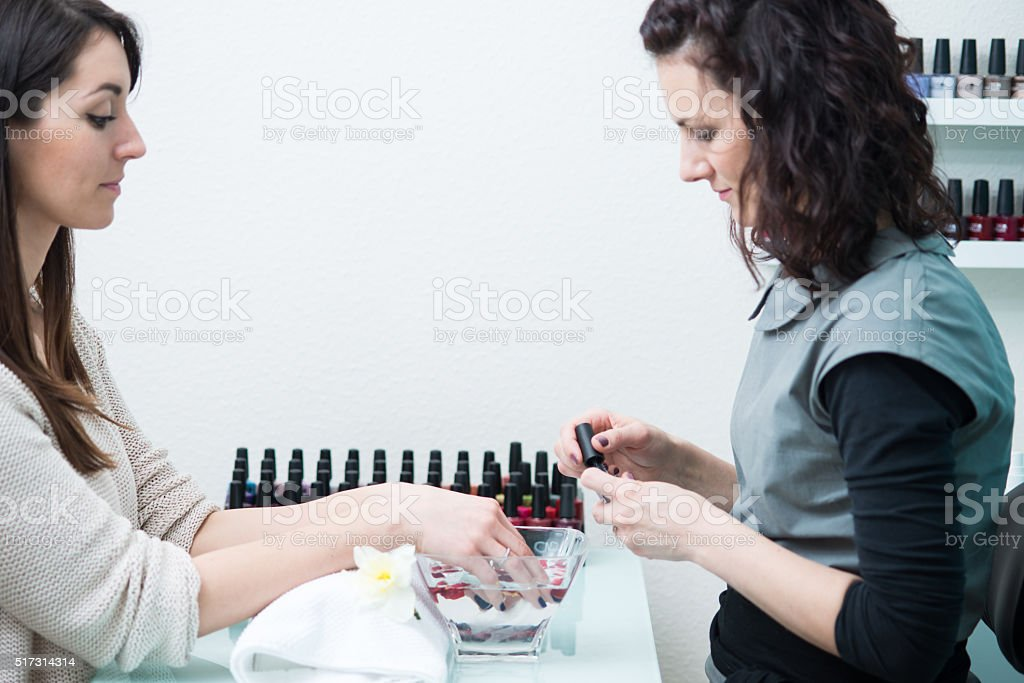 Beautician Varnishing Nails at Beauty Salon, Europe stock photo
