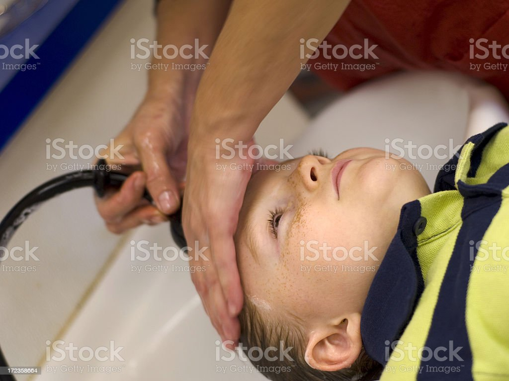 Beautician Washing Child's Hair in Sink, Boy at Beauty Salon stock photo