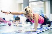 Beautifil blonde woman doing pilates
