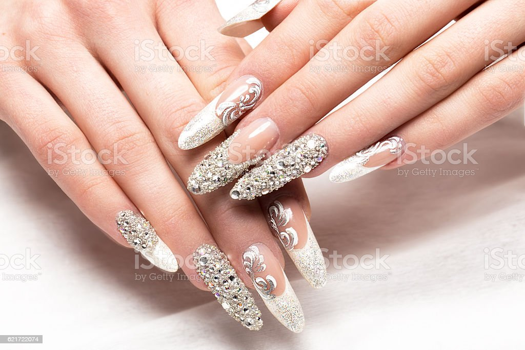 Beautifil wedding manicure for the bride in gentle tones with stock photo