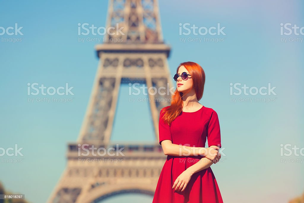 Beautifu girl in Paris with Eiffel tower on background. stock photo