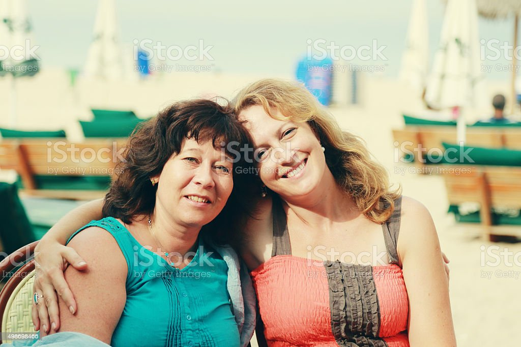 beautiful 40 years old women sitting in the beach cafe stock photo