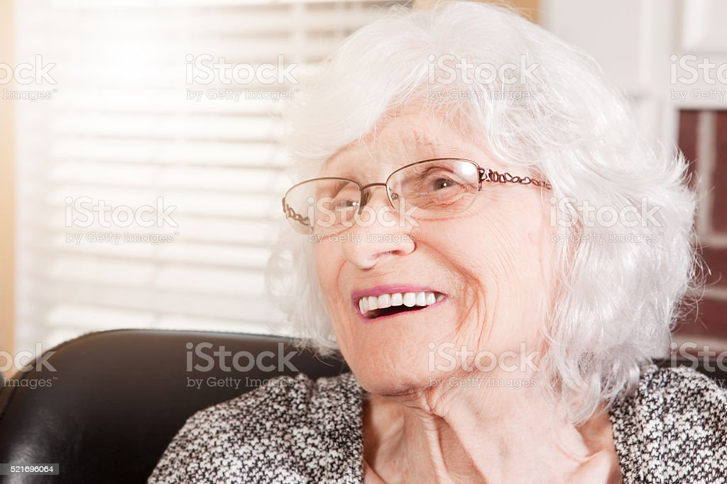 Beautiful 88 Year Old Woman Laughing stock photo