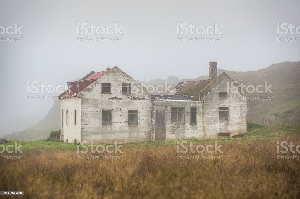 Beautiful abadoned house in the fog stock photo