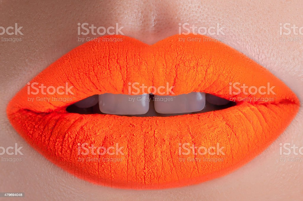 Beautiful acid orange lips stock photo