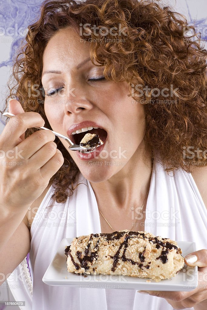 Beautiful adult woman eating dessert royalty-free stock photo