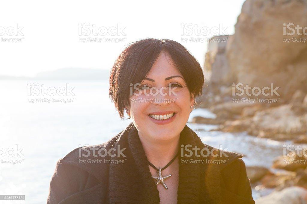 Beautiful Adult Woman Smiling at Sunset stock photo
