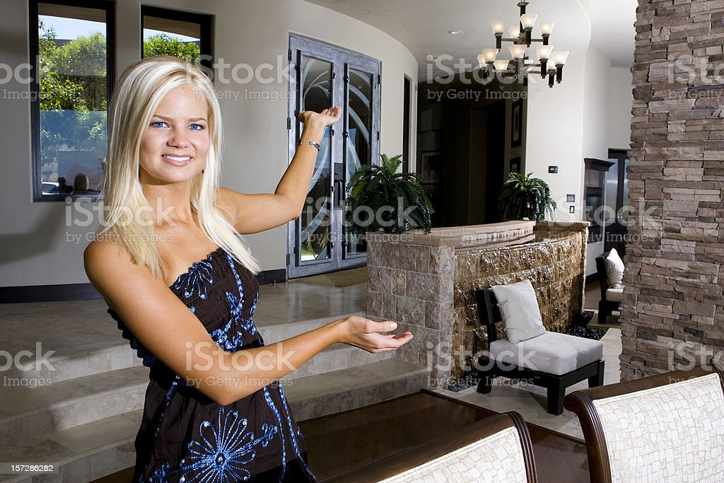 Beautiful Affluent Homeowner Presenting House stock photo