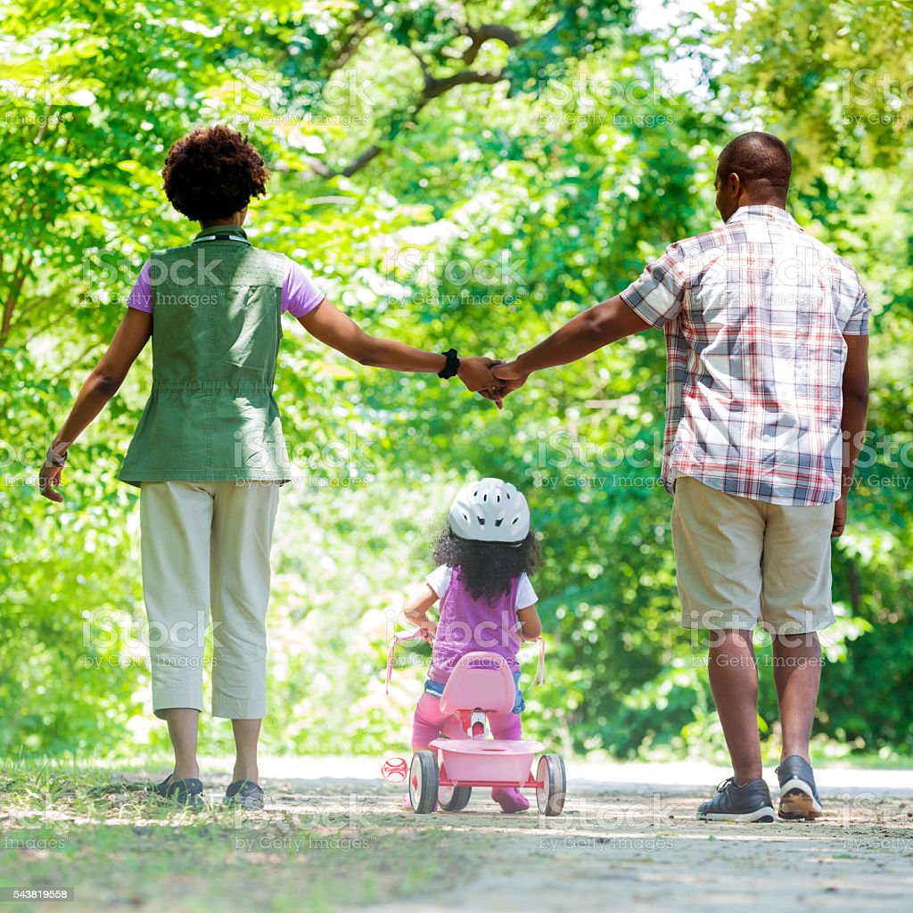 Beautiful African American family on a walk in the park stock photo