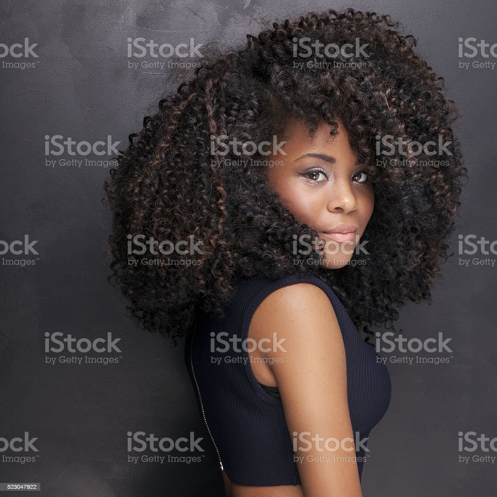 Beautiful african american girl posing in elegant dress. stock photo