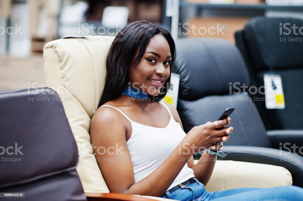 Beautiful african american woman  in a store. stock photo