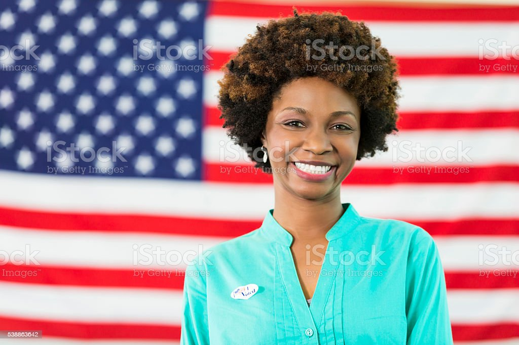 Beautiful African American Woman in front of American flag stock photo