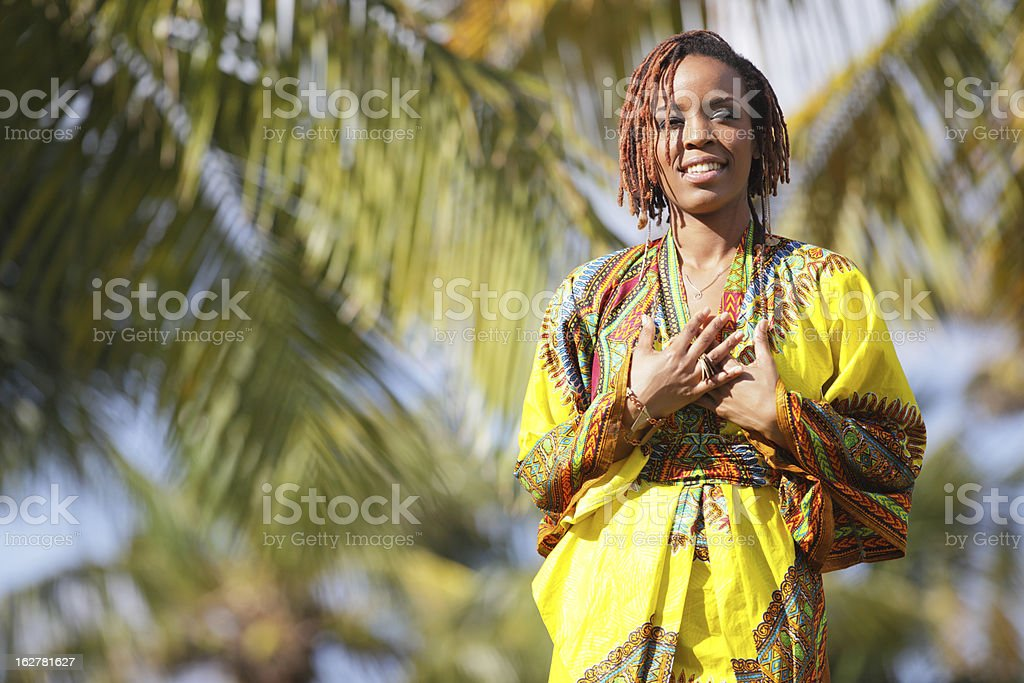 Beautiful African American woman in the park stock photo