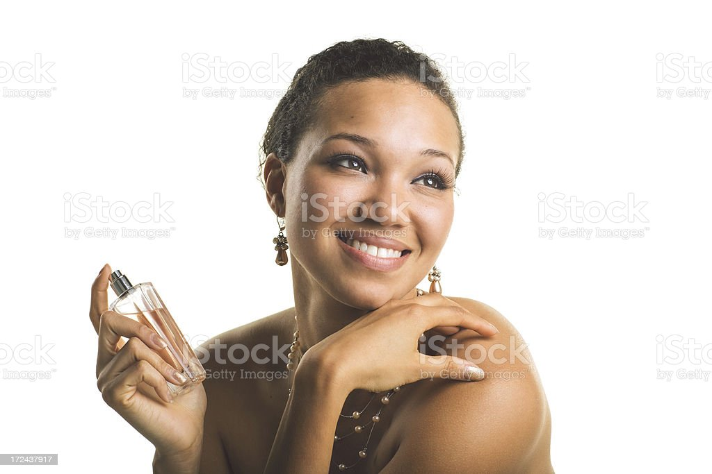 beautiful african american woman with perfume looking away royalty-free stock photo