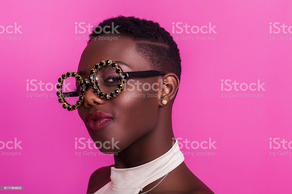 Beautiful african girl portrait wearing odd glasses and smiling stock photo