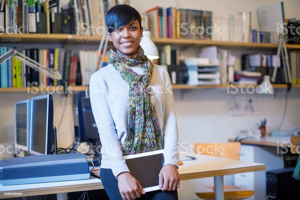 Beautiful african woman with digital tablet at startup stock photo