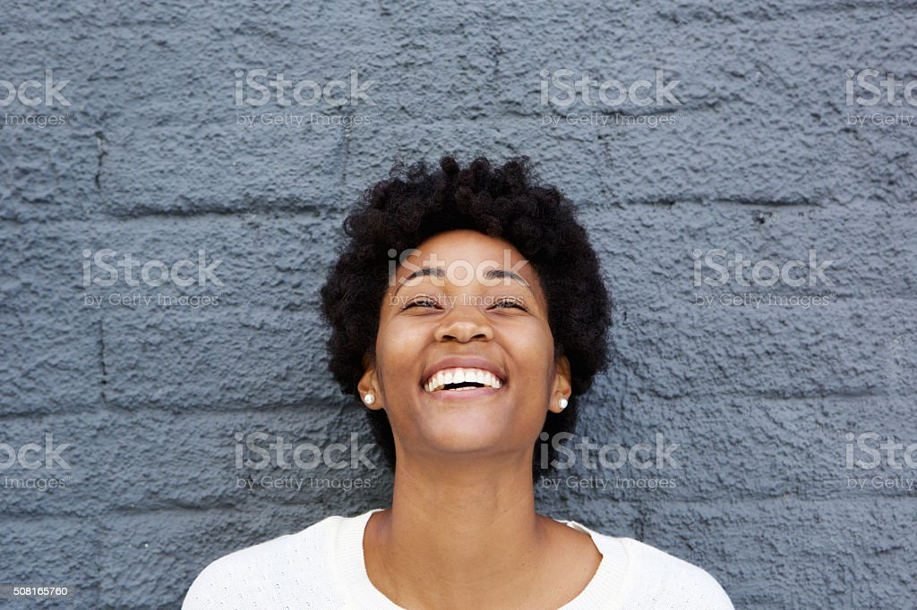 Beautiful african young woman laughing stock photo