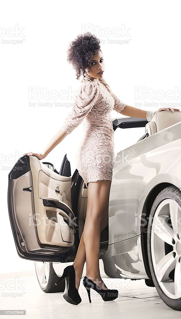 Beautiful African-American woman next to convertible car. royalty-free stock photo
