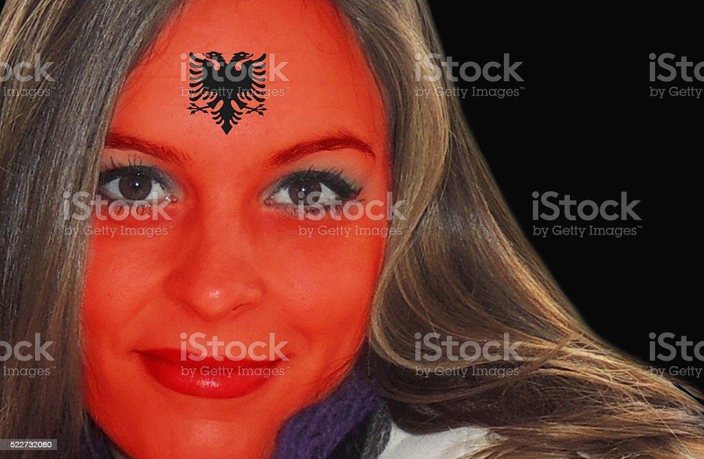 Beautiful Albanian lady fan stock photo